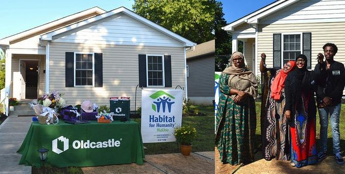 Habitat house with homeowners standing in front of it