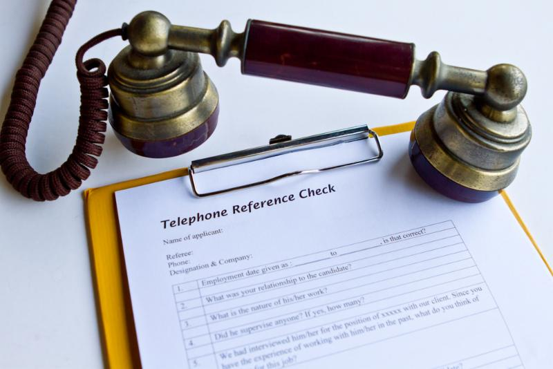 Old fashioned telephone by a notepad
