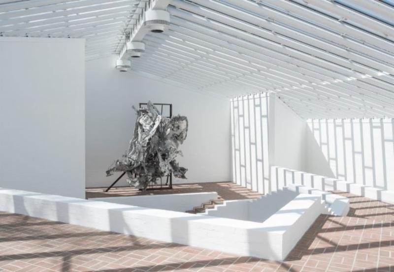 Metal sculpture underneath skylights