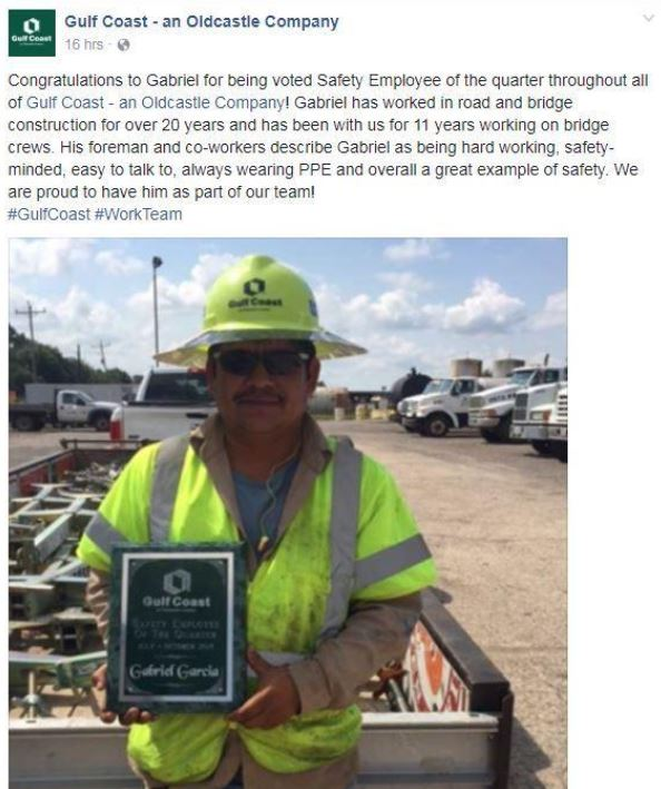 Employee in hardhat holding an award