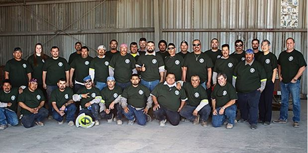 Group photo of employees in matching t shirts