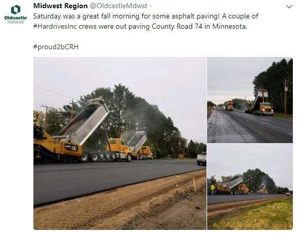 Crews paving a road
