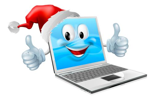 Smiling laptop wearing a santa hat and giving two thumbs up