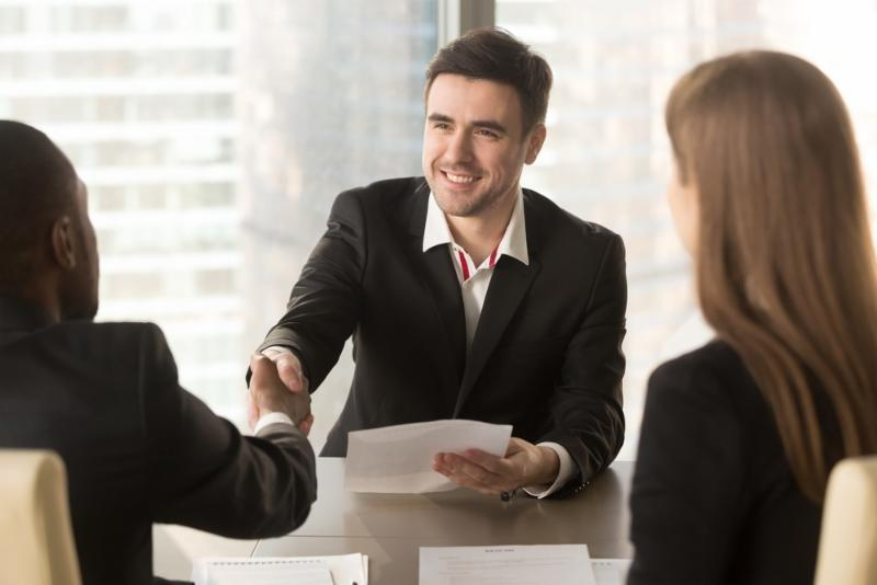 Candidate shaking employer's hand