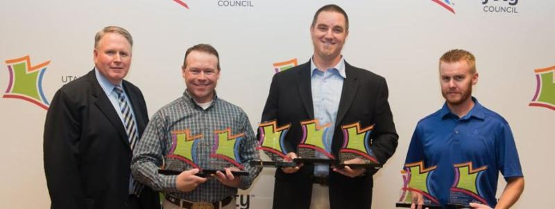 Employees with safety awards in their hands
