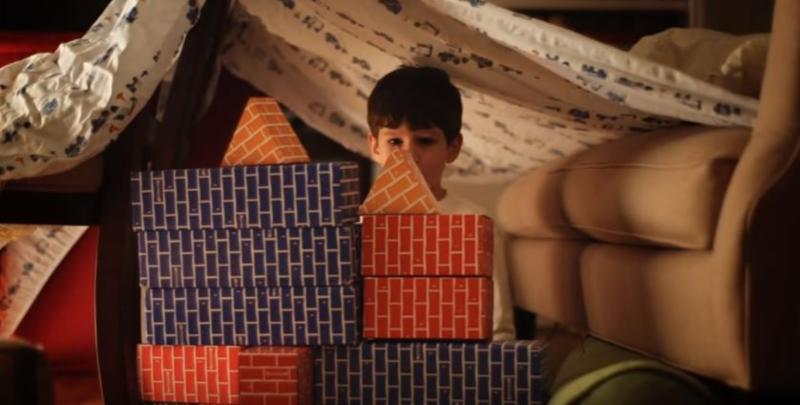 boy building a fort with blocks