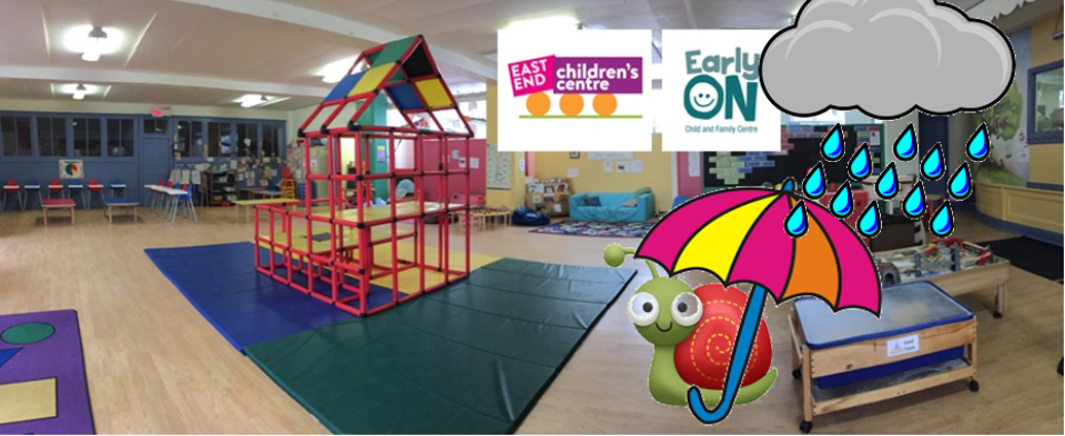 children's indoor playspace with climbing apparatus in the centre of the room and clipart snail with umbrella under a rain cloud