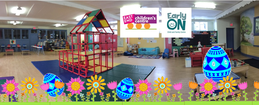 children's indoor play space with a climbing structure in the centre of the room and cartoon drawings of a flower garden and blue Greek Easter eggs in the foreground