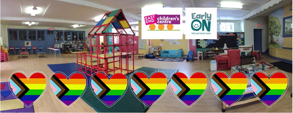 children's indoor play space with six rainbow pride hearts across the bottom of the image