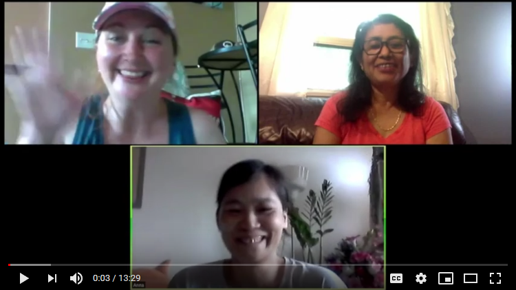 an online conference between a white person wearing a hat and waving in the top left of the screen and a brown person with dark haird and an orange shirt in the top right of the screen and an Asian person with dark hair waving in the bottom centre