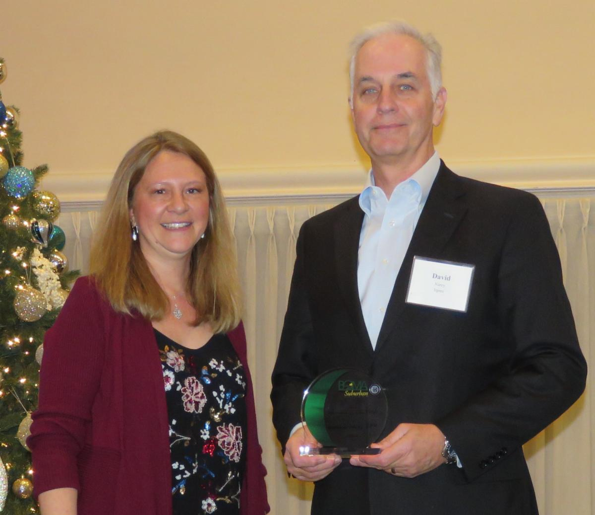 2018 Member of the Year David Narey, CPM, Irgens, pictured with 2015 Member of the Year Suzanne Boryscka, RPA, Lincoln Property Company