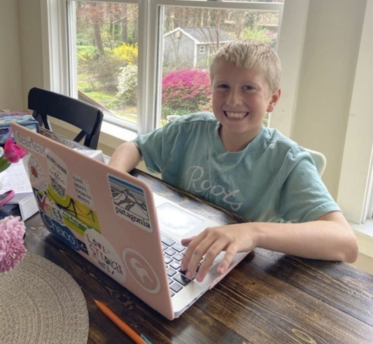 Student engaged in digital learning at home.