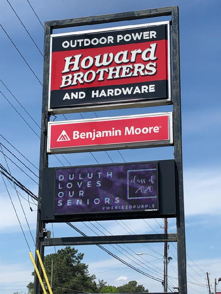 """Howard Brothers billboard showing message, """"Duluth loves our seniors."""""""