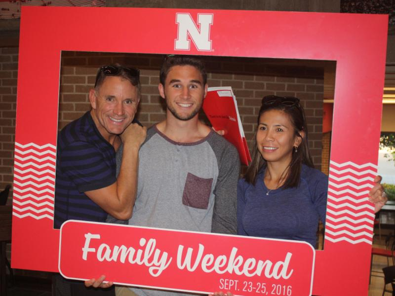 Family poses for picture at Family Weekend