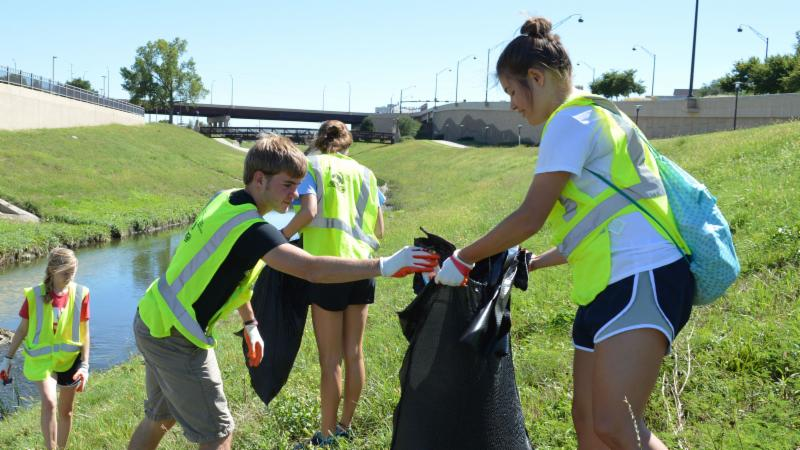 Students collect litter near Antelope Valley Creek.