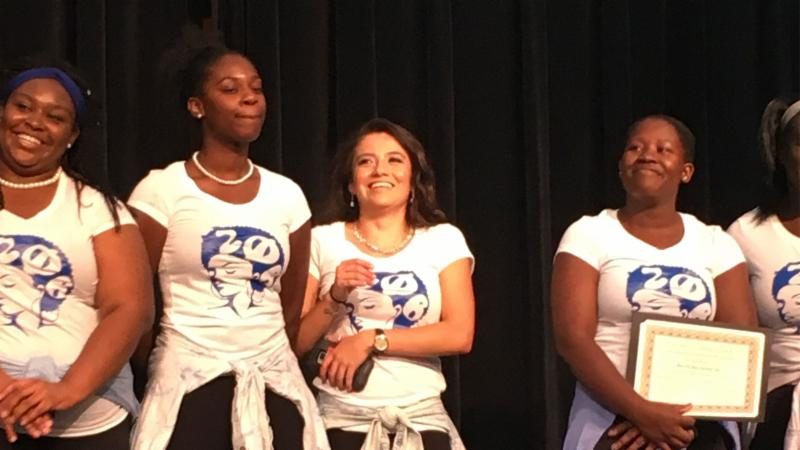 Zeta Phi Beta sorority receives a certificate for winning the sorority category at the OASIS Stroll Off.