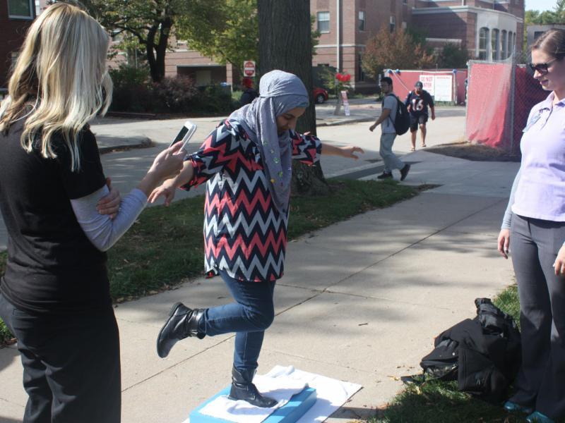 Nebraska student stands on one leg