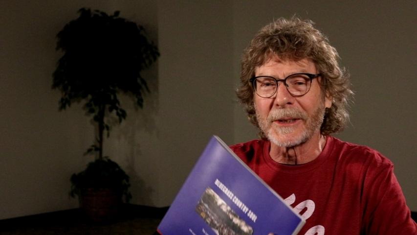 Sam Bush Holding the BGCS Book