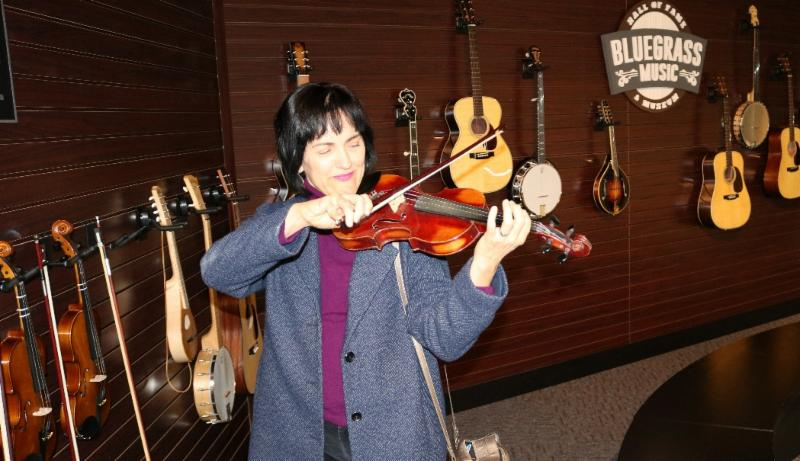 Executive Director Ellen Pasternack playing fiddle