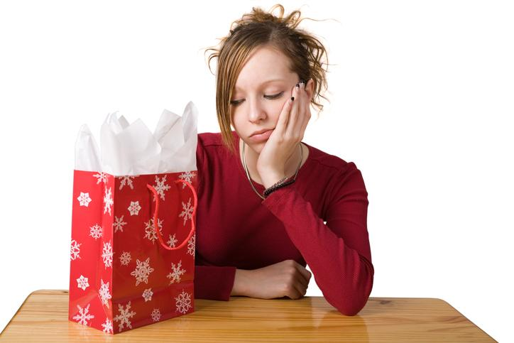 young woman disappointed in gift