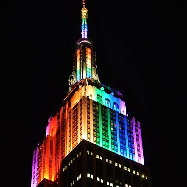 The empire state building lit in rainbow colors to celebrate pride