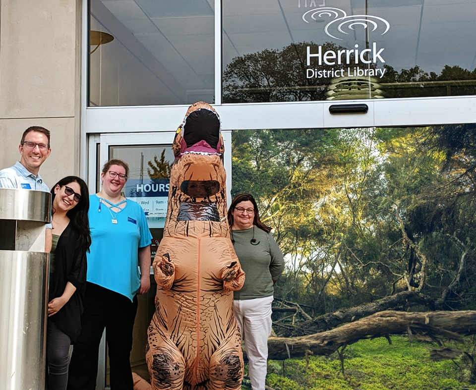 Herrick District Library Staff posing in front of library.