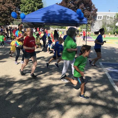 Students running laps around the school's playground.