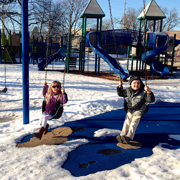 Kids playing on the Franklin playground in winter.
