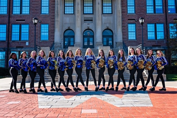Madison West Dance Team in front of West High School.