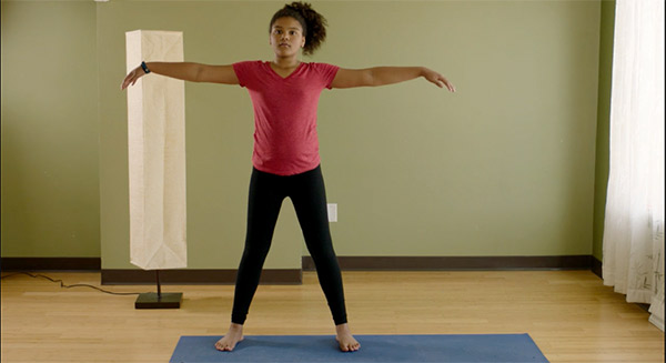 Still from a video of a girl doing the windmill pose.