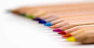 Colored pencils lined up in a row.
