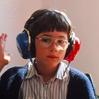 A boy wearing headphones undergoing a hearing test.