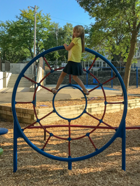 A student having fun on the Franklin playground.