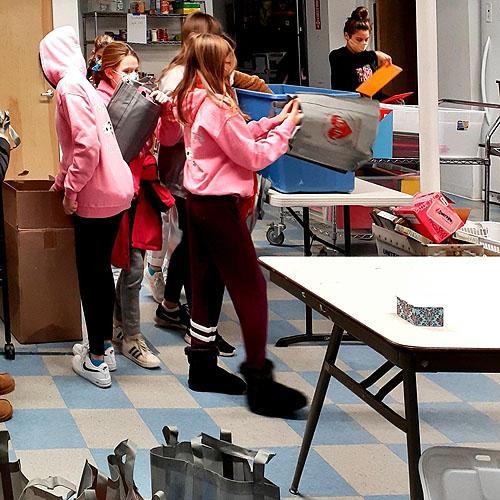 Girl Scouts Volunteering in Pantry