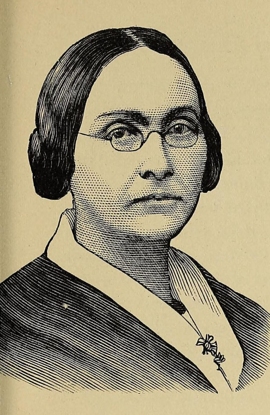 Black and white portrait of a person, Graceanna Lewis, wearing glasses.