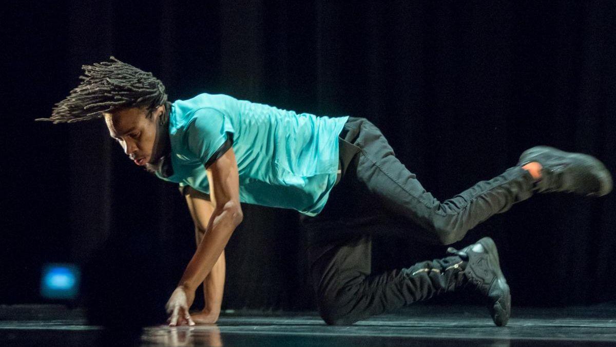 On a stage, a dancer twirls.