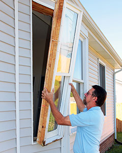 Photo of man replacing window.