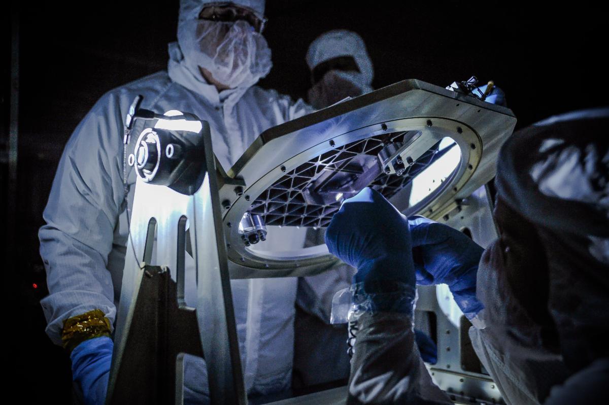 Engineers at NASA's Goddard Space Flight Center inspect a component for the James Webb Space Telescope. (NASA Goddard/Chris Gunn).