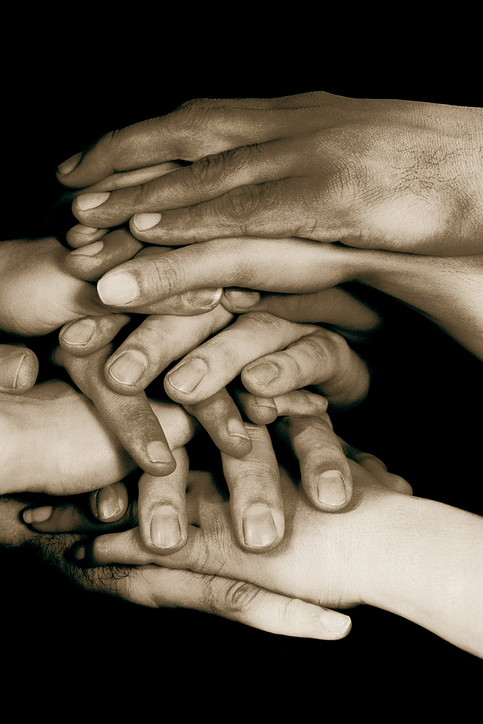 sepia_stacked_hands.jpg